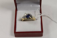 An antique sapphire and diamond ring.