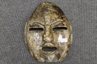 A hardstone Inuit wall mask, width 27 cm.