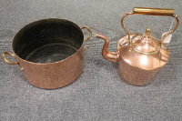 A Victorian copper kettle, together with copper twin handled pan, a brass pan and two brass jardinieres. (5)
