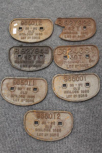 A collection of seven cast metal railway wagon plates. (7)