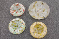 Four early twentieth century marbled glass light shades. (4)