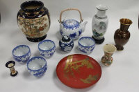 A collection of Chinese and Japanese ceramics including vases, blue and white sake set, Satsuma miniature vase, a lacquered dish and cloisonne vase. (12)