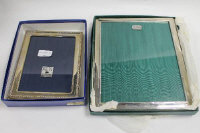Two sterling silver photograph frames, boxed. (2)