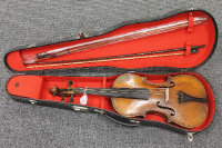 A violin with two bows, cased.