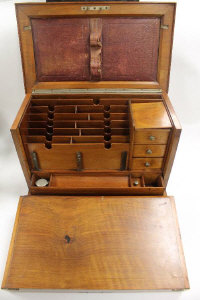 An early twentieth century burr walnut writing box, width 41 cm.