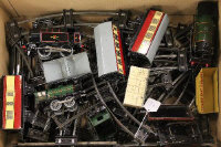 A collection of Hornby O'gauge tin plated train items including three engines, rolling stock and track. (Q)