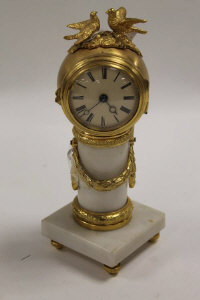 An ormolu mounted white marble miniature time piece, height 17.5 cm.