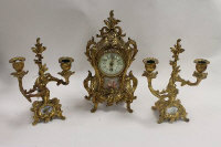 A French three piece ormolu clock set with white porcelain panels. (3)