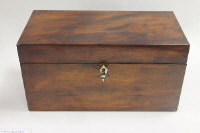 A nineteenth century mahogany tea caddy, with key, width 30.5 cm.