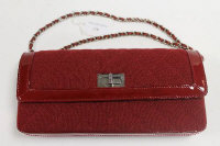 A Chanel red leather and cloth hand bag, with authenticity card no. 7023765.