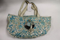 A Guess floral patterned hand bag.