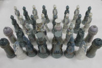 A thirty two piece Lladro chess set. (32)