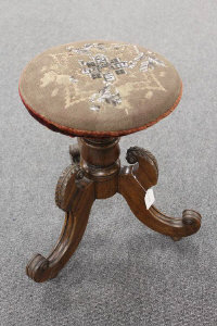 An early Victorian rosewood revolving embroidered adjustable stool.