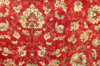 A Kashmir fringed rug with floral borders on red ground, 122 cm x 244 cm.