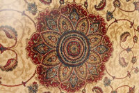 A Kashmir fringed rug with medallion centre on cream ground, 135 cm  x 200 cm.