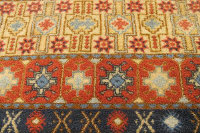 A Moroccan wool fringed carpet of geometric design on red ground, 160 cm x 270 cm.