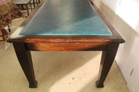 An Edwardian oak office table, length 244 cm.