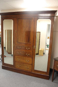 A late Victorian inlaid mahogany compactum wardrobe, width 188 cm, together with the matching dressing table. (2)