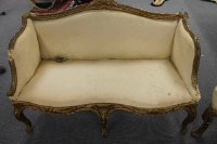 A Victorian gilt framed settee, with shell scroll frieze, width 130 cm, together with a high backed armchair and salon chair. (3)