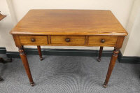 A Victorian mahogany three drawer writing table, width 91 cm.