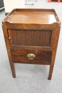 A Victorian mahogany shutter fronted bedside cabinet, fitted with a drawer, width 48 cm.