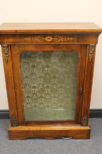 A Victorian inlaid mahogany ormolu mounted pier cabinet, width 79 cm.