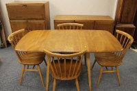 A light elm Ercol seven piece dining room suite, comprising of sideboard, width 129 cm, drop end table, four chairs and storage cabinet. (7)
