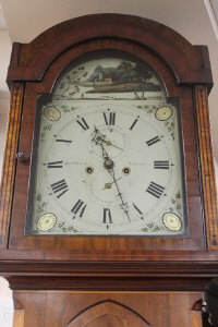 A late eighteenth century inlaid mahogany longcased clock, with painted dial by George Stewart Newcastle. Provenance: The clock became the possession of William Latimer Middleton in the early twentieth century, he was a distinguished airman during WW II,  shot down twice over the English Channel, he was awarded the DFC, the interior door contains more historical information.