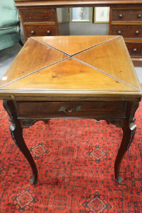 A Victorian mahogany envelope card table, width 55 cm.