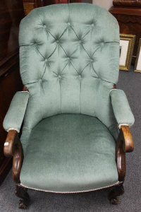 A Victorian mahogany buttoned back armchair.