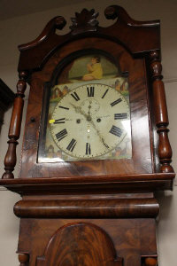 A Victorian mahogany longcased clock with painted dial.