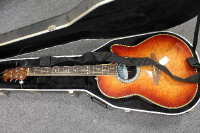 An Ovation Celebrity semi acoustic guitar, model CS-157, cased.