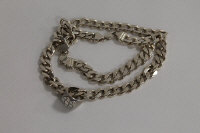 A sterling silver curb chain, together with a sterling silver ring. (2)
