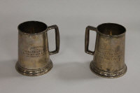 A pair of white metal tankards, presented to Major and Mrs N.E.Forth by the Officers of 41 B.G.H. 1st January 1946. 26 oz. (2)
