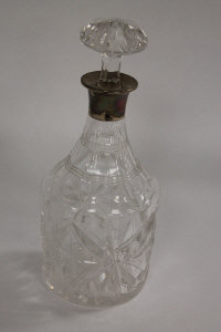 A cut glass silver mounted decanter, Birmingham 1914.