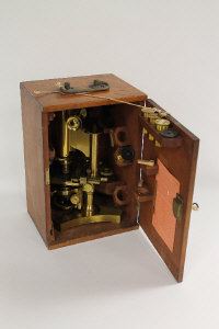 A brass achromatic microscope by R & J Beck Ltd. London, in a fitted mahogany case.