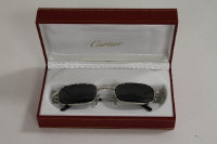 A pair of Cartier tinted spectacles, cased.