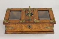 An Edwardian oak and brass mounted table box, width 31 cm.