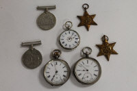 Four WW II defence medals, together with three continental silver pocket watches. (7)