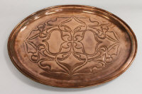 An Arts and Crafts copper charger, indistinctly stamped, width 59.5 cm.