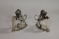 A pair of silver plated Lion epergne holders by Walker & Hall, height 12.5 cm. (2)