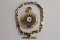 An A.W.Waltham pocket watch, suspended on a 9ct gold Albert chain. (2)