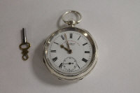 A silver pocket watch, Chester 1900, J.G.Graves Sheffield, with key.