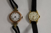 A 9ct gold Lady's wrist watch, together with a Dulux Lady's watch. (2)