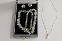 A sterling silver and crystal necklace, with matching earrings, together with a pearl pendant on silver chain. (4)