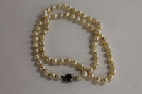 A pearl necklace, with 14ct white gold sapphire mounted clasp, length 60 cm.