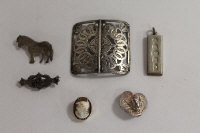 A silver belt buckle, Birmingham 1910, together with three silver brooches, a silver ingot and a 9ct gold mounted cameo brooch. (6)