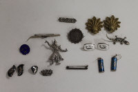Seventeen sterling silver and continental white metal earrings and brooches. (17)