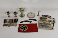 A group of five WW II medals awarded to Michael Edwin Rathlin Mannox, Chaplain to the forces, together with his three piece silver field communion set, two further silver cups and a collection of German souvenirs, field service postcards and badges. (Q)