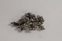 A diamond floral cluster brooch, width 6.5 cm.